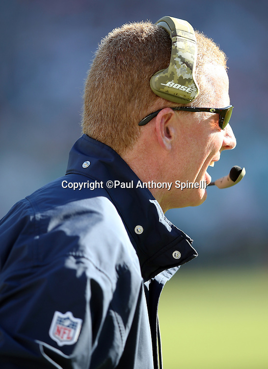 Dallas Cowboys head coach Jason Garrett claps yells out from the sideline during the 2015 week 11 regular season NFL football game against the Miami Dolphins on Sunday, Nov. 22, 2015 in Miami Gardens, Fla. The Cowboys won the game 24-14. (©Paul Anthony Spinelli)