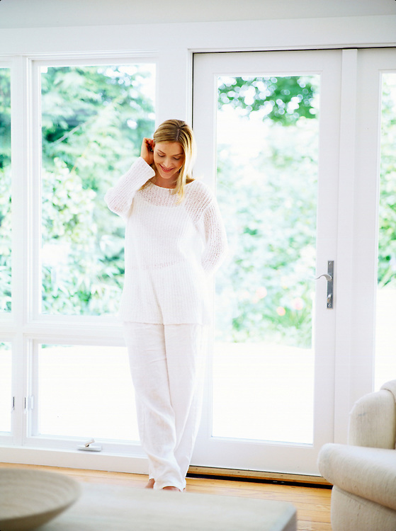 Fashion & Beauty Photography - Kim photographed standing in white room wearing white in Seattle, WA