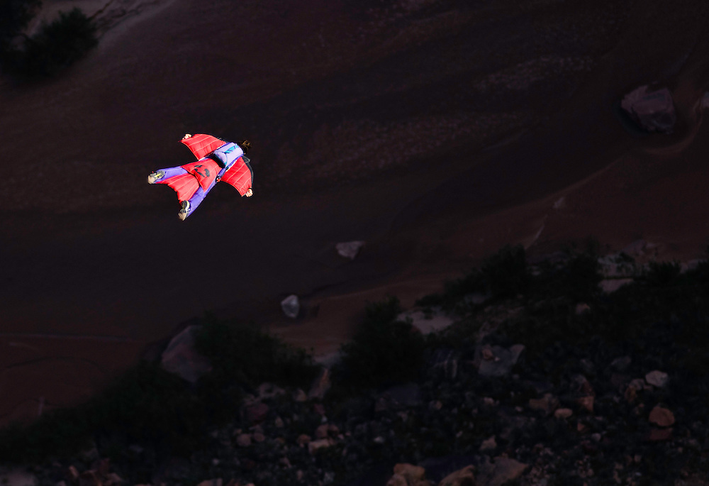 Dean Potter flys his wingsuit into a deep desert canyon somewhere in the American southwest.