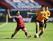 Aaron Cresswell of West Ham United and Raul Jimenez of Wolverhampton Wanderers during the Premier League match at the London Stadium, London. Picture date: 20th June 2020. Picture credit should read: David Klein/Sportimage