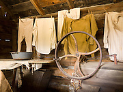 "An 1890s era laundry building is restored in Nevada City, Montana, USA. In 1870, Chinese people (nearly all male) made up 10% of the territorial population of Montana. Territorial laws prohibited ""China Men"" from owning placer claims, so they mined the leavings of others or performed laundry or domestic service, which was always in great demand. Today, Nevada City contains several fascinating Chinese buildings built about 1890, mostly moved here from Butte, Montana. Nevada City was a booming placer gold mining camp from 1863-1876, but quickly declined into a virtual ghost town. This fascinating town inspires you to imagination what life must have been like in early Montana when gold was discovered at nearby Alder Gulch. More than 90 buildings from across Montana have been gathered for preservation at Nevada City, mostly owned by the people of the State of Montana, and managed by the Montana Heritage Commission. In 2001, the excellent PBS television series ""Frontier House"" used one of the buildings and its furnishings to train families in re-creating pioneer life. A miner's court trial and hanging of George Ives in the main street of Nevada City was the catalyst for forming the Vigilantes, a group of citizens famous for taking justice into their own hands in 1863-1864. Directions: go 27 miles southeast of Twin Bridges, Montana on Highway 287."