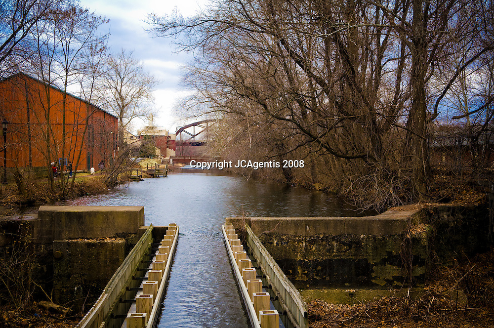 Canal in Bethlehem Pennsylvania Lehigh Valley with bridge in the distance.