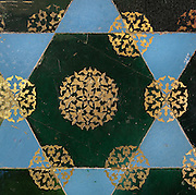 Tile decoration of green octagonal and turquoise triangular tiles with gold decoration found in the rooms to the sides of the mosque after the vestibule, Green Mosque or Yesil Cami, Bursa, Turkey. The Green Mosque was built under Sultan Mehmed Celebi in 1419-21 by the architect Haci Ivaz Pasha. The painted decorations were by Ali bin Ilyas and Mehmed el Mecnun. Following an earthquake in 1855, the building underwent an extensive renovation led by architect Leon Parvillee. Picture by Manuel Cohen