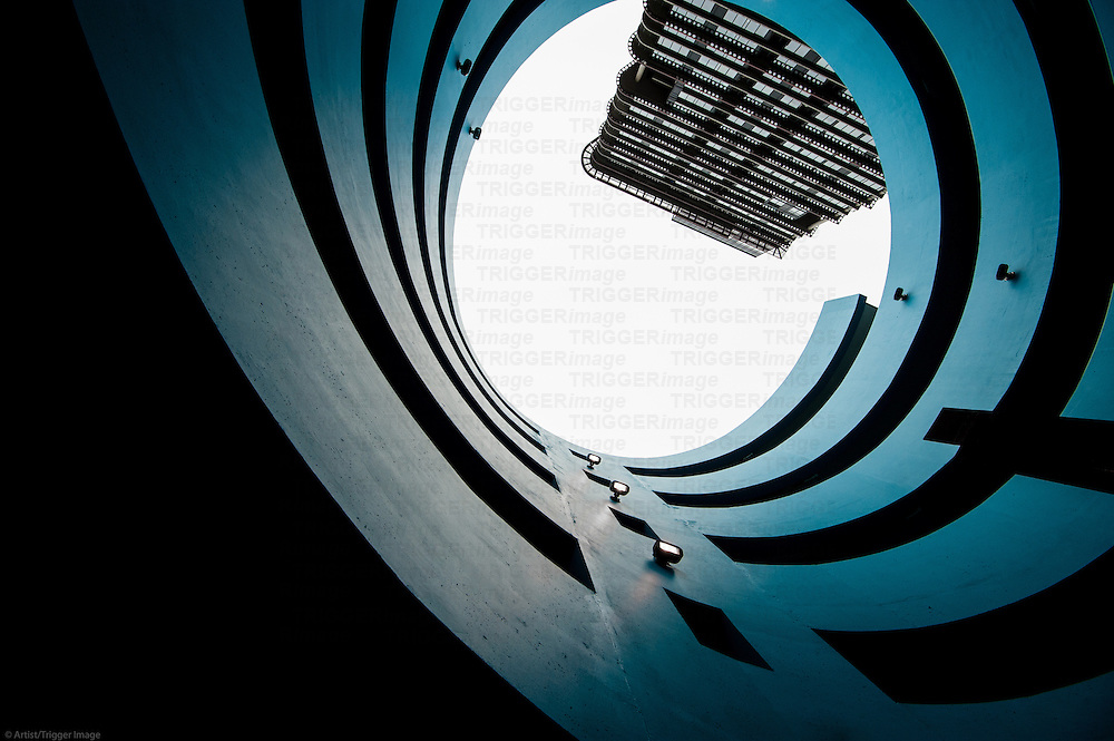 Looking up and out from a spiral parkade.