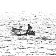 Cornwall. Cornish Fisherman. From St Ives bay.<br /> <br /> St Ives (Cornish: Porth Ia, meaning St Ia's cove) is a seaside town, civil parish and port in Cornwall, England, United Kingdom. The town lies north of Penzance and west of Camborne on the coast of the Celtic Sea. In former times it was commercially dependent on fishing. The decline in fishing, however, caused a shift in commercial emphasis, and the town is now primarily a popular holiday resort, notably achieving the title of Best UK Seaside Town from the British Travel Awards in both 2010 and 2011. St Ives was incorporated by Royal Charter in 1639. St Ives has become renowned for its number of artists. It was named best seaside town of 2007 by the Guardian newspaper. It should not be confused with St Ive, a village and civil parish in south-east Cornwall.