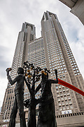 The Tokyo Metropolitan Government Building (Tokyo Tocho) in Shinjuku, Japan, offers free observation decks for panoramic views of Tokyo and beyond. The 243 meter tall building has two towers, and each houses an observatory at a height of 202 meters.
