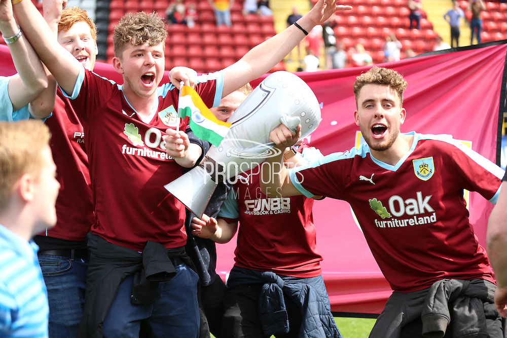 Burnley fans celebrating winning the league on the Valley pitch during the Sky Bet Championship match between Charlton Athletic and Burnley at The Valley, London, England on 7 May 2016. Photo by Matthew Redman.
