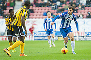 Yanic Wildschut of Wigan Athletic looks to beat Jermaine Grandison of Shrewsbury Town during the Sky Bet League 1 match at the DW Stadium, Wigan<br /> Picture by Matt Wilkinson/Focus Images Ltd 07814 960751<br /> 21/11/2015