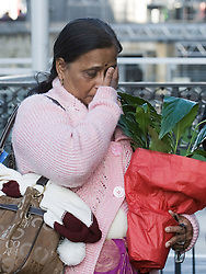 © Licensed to London News Pictures. 04/01/2012. London, UK.  YOGINI BIDVE, mother of murdered indian student ANUJ BIDVE wipes a tear from her eye as she arrives at the Houses of Parliament London on January 4th, 2012 after arriving in the UK from Mumbai. The Family of 20 year-old ANUJ BIDVE, are expected to travel to Manchester to visit the scene where ANUJ was shot dead.  Photo credit: Ben Cawthra/LNP