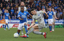 Siriki Dembele of Peterborough United in action with James Bolton of Portsmouth - Mandatory by-line: Joe Dent/JMP - 07/03/2020 - FOOTBALL - Weston Homes Stadium - Peterborough, England - Peterborough United v Portsmouth - Sky Bet League One