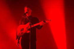 © Licensed to London News Pictures. 24/09/2014. London, UK.   Alt J performing live at Alexandra Palace.  In this picture - Joe Newman.  Alt-J is an English indie rock consisting of members Joe Newman (guitar/lead vocals), Thom Green (drums), and Gus Unger-Hamilton (keyboard/vocals).   They won the 2013 British Mercury Prize with their debut album An Awesome Wave.   Their second album, This Is All yours, was released on 22 September 2014.  Their original bassis Gwil Sainsbury left the band in early 2014, he is replaced by Cameron Knight for their live tour.   Photo credit : Richard Isaac/LNP
