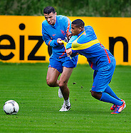 NETHERLANDS, HOENDERLOO : Dutch international football player Khalid Boulahrouz  (l) duel with Luciano Narsingh   at the trainingcamp of the Netherlands national football team in Hoenderloo on May 31, 2012. AFP PHOTO/ ROBIN UTRECHT