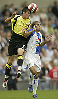 Photo: Aidan Ellis.<br /> Blackburn Rovers v Manchester City. The Barclays Premiership. 17/09/2006.<br /> City's Stephen Jordan beats Rovers David Bentley to the ball