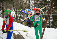 U14's Nathaniel Weimer and Cameron Summerton make their way to the top of the K20 jump during GNA's ski jump meet on Saturday morning.   (Karen Bobotas/for the Laconia Daily Sun)