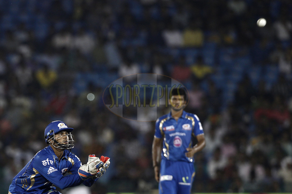 Aditya Tare of the Mumbai Indians  during the qualifier 6 match of the Oppo Champions League Twenty20 between the Mumbai Indians and the Northern Knights held at the Chhattisgarh International Cricket Stadium, Raipur, India on the 16th September 2014<br /> <br /> Photo by:  Deepak Malik / Sportzpics/ CLT20<br /> <br /> <br /> Image use is subject to the terms and conditions as laid out by the BCCI/ CLT20.  The terms and conditions can be downloaded here:<br /> <br /> http://sportzpics.photoshelter.com/gallery/CLT20-Image-Terms-and-Conditions-2014/G0000IfNJn535VPU/C0000QhhKadWcjYs