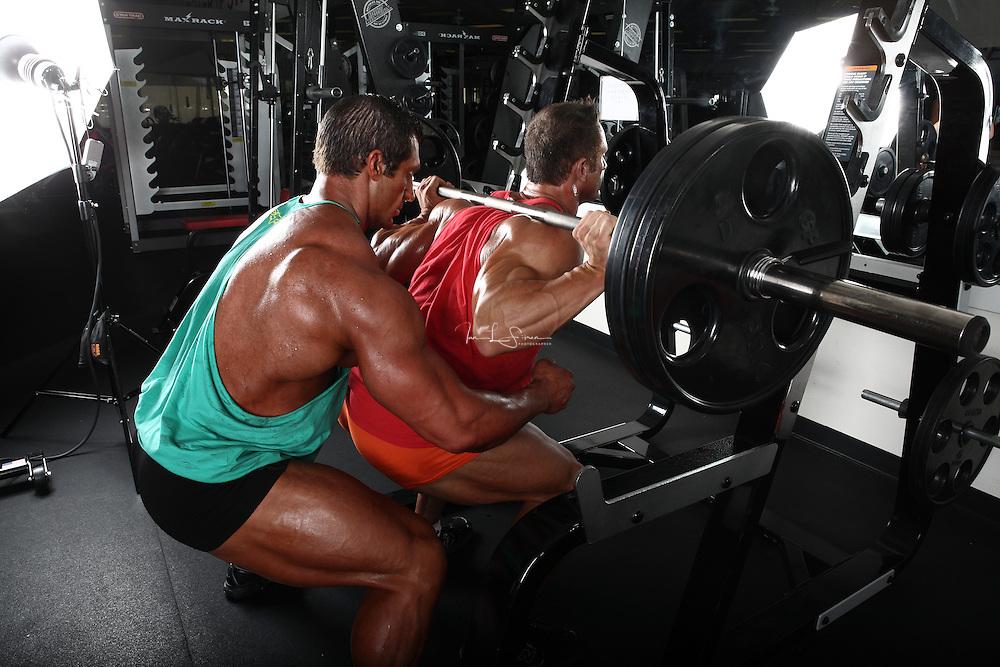 Bodybuilders Dan Decker and Brian Yersky doing squats.
