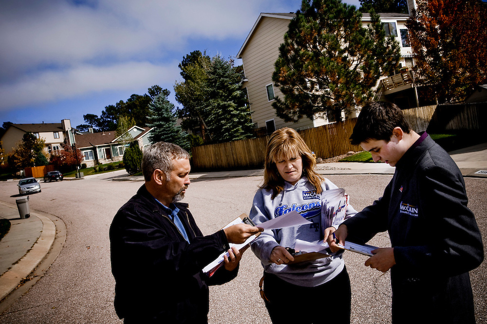 Volunteers in Colorado Springs....McCain campaign volunteers Pete and Irene Knudsen with Alex Johnson (right) canvasing in a Colorado Springs suburb....Photographer: Chris Maluszynski /MOMENT
