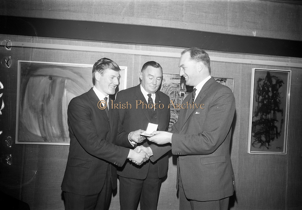 16/12/1965<br /> 12/16/1965<br /> 16 December 1965<br /> <br /> <br /> Apprentice of the Year Award at Building Centre in Dublin<br /> <br /> Picture shows Mr. George Colley T.D.(right) Minister for Education presenting the gold medal to James Phelan with Mr. John G Sisk Managing director of John Sisk&Son Ltd.