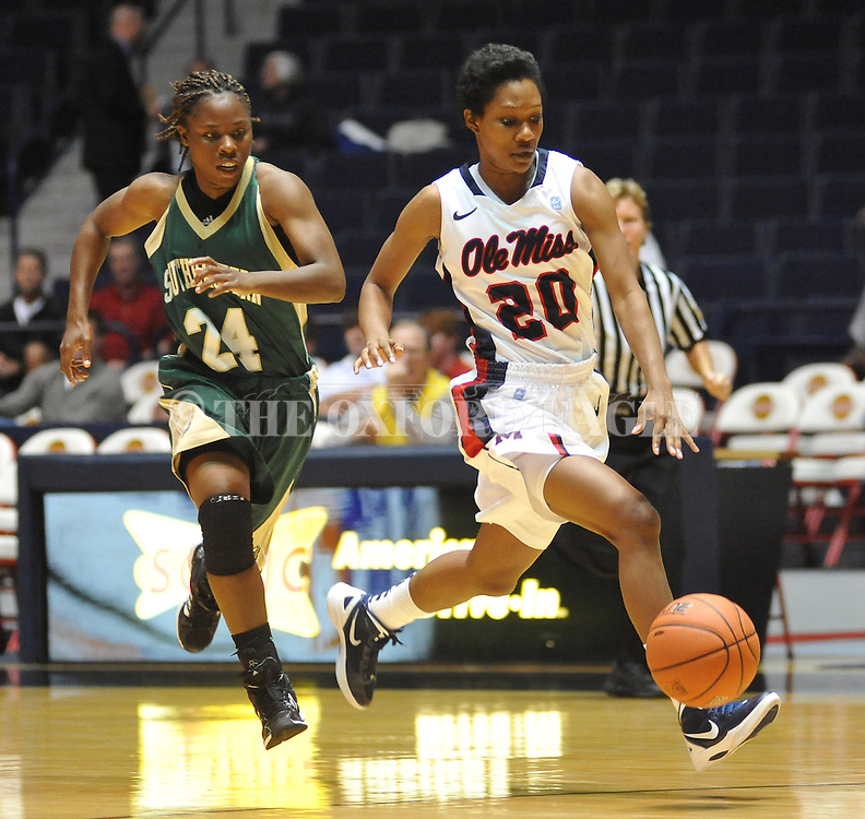 Mississippi's Amber Singletary (20) dribbles against Southeastern Louisiana's Symone Miller (24) in Oxford, Miss. on Friday, November 9, 2012. (AP Photo/Oxford Eagle, Bruce Newman)