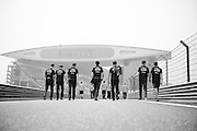 April 15-17, 2016: Chinese Grand Prix, Shanghai, Red Bull mechanics walk back to the pitlane