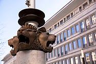 Germany, Cologne, lion heads on a flagpole in the Gerling Quarter.<br /> <br /> Deutschland, Koeln, Loewenkoepfe an einem Fahnenmast im Gerling Quartier.