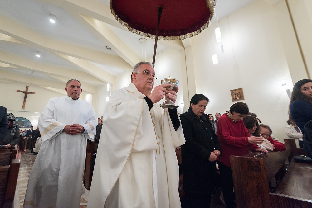 20 April 2019, Jerusalem: Father Najeeb leads a procession, chalice in hand, during Holy Saturday service at Saint James' Church in Beit Hanina, Jerusalem.