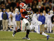 ATHENS, GA - NOVEMBER 23:  Tailback Todd Gurley #3 of the Georgia Bulldogs is tackled by linebacker Khalid Henderson #22 of the Kentucky Wildcats during the game at Sanford Stadium on November 23, 2013 in Athens, Georgia.  (Photo by Mike Zarrilli/Getty Images)