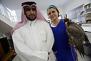 Doha Falcon Hospital. Mr. Hamad and one of his falcons. A young veterinarian from Germany.