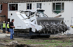 ©  licensed to London News Pictures. 01/07/2011. Gravesend, Kent. Jeremy Clarkson using a remote controlled Armtrac . Top Gear presenters Jeremy Clarkson, James May and Richard Hammond smashing up old houses in Gravesend, Kent with tanks during filming for Top Gear today (01/07/2011). See special instructions. Photo credit Grant Falvey/LNP.