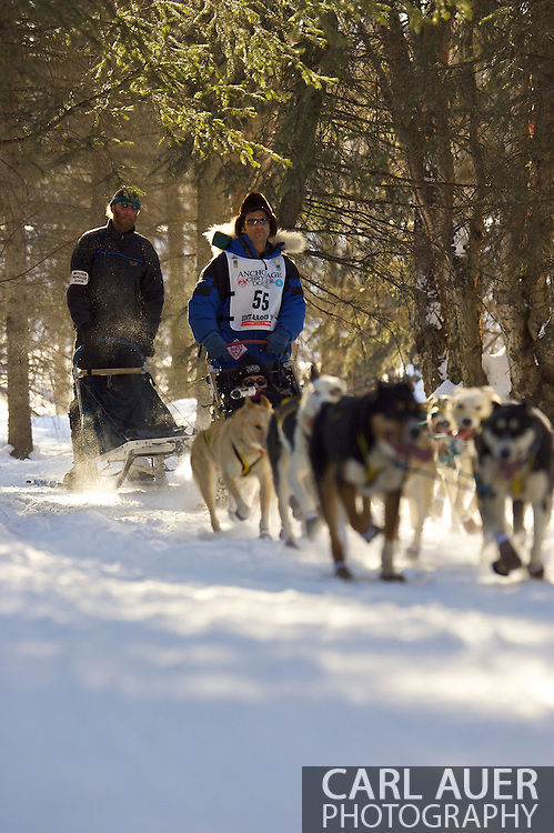 March 7th, 2009:  Anchorage, Alaska - Hugh Neff out of Skagway, Alaska takes his team through the woods near the Alaska Native Hospital during the ceremonial start of the 37th Iditarod.