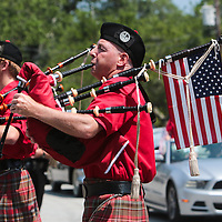 Members of the N.C. State Pipes and Drums Band perform during the North Carolina 4th of July Festival Parade Friday July 4, 2014 in Southport, N.C.