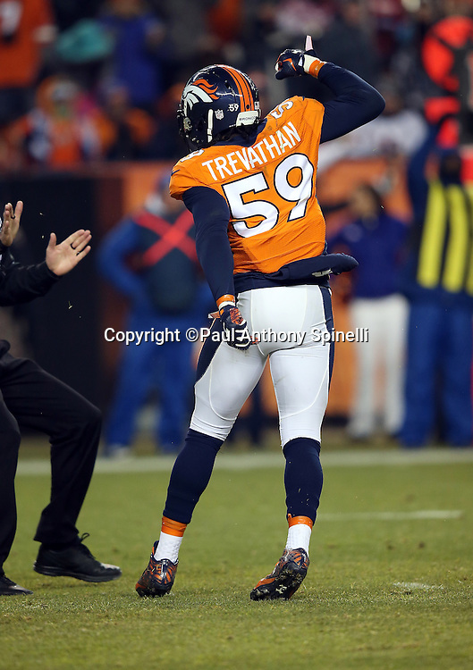 Denver Broncos inside linebacker Danny Trevathan (59) pumps his fists in celebration after stuffing a third quarter play during the 2015 NFL week 16 regular season football game against the Cincinnati Bengals on Monday, Dec. 28, 2015 in Denver. The Broncos won the game in overtime 20-17. (©Paul Anthony Spinelli)