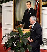 Georgia Gov. Nathan Deal walks past a portrait of former Gov. Carl Sanders after making remarks at Second Ponce de Leon Baptist Church on Saturday, Nov. 22, 2014, in Atlanta. Six living Georgia governors attending the service included Deal and former governors Jimmy Carter, Sonny Perdue, Roy Barnes, Zell Miller, and Joe Frank Harris. Photo by David Tulis