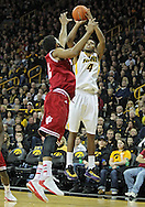 December 31 2012: Iowa Hawkeyes guard/forward Roy Devyn Marble (4) puts up a shot over Indiana Hoosiers forward Christian Watford (2) during the first half of the NCAA basketball game between the Indiana Hoosiers and the Iowa Hawkeyes at Carver-Hawkeye Arena in Iowa City, Iowa on Monday December 31, 2012. Indiana defeated Iowa 69-65.