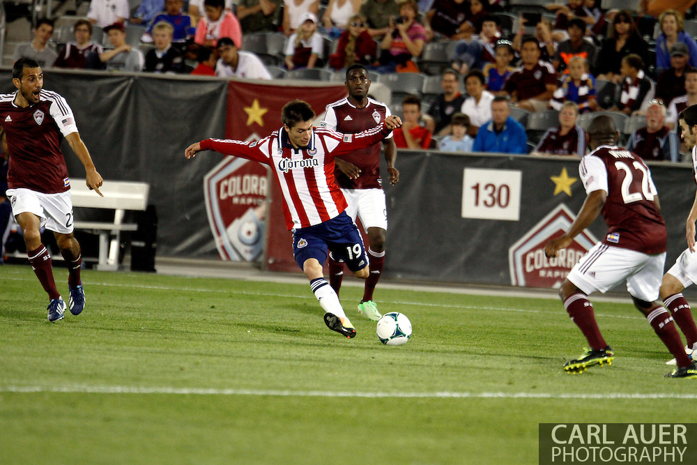 May 25th, 2013 Commerce City, CO - Chivas USA defender/midfielder Jorge Villafaña (19) winds up for a shot in the second half of the MLS match between Chivas USA and the Colorado Rapids at Dick's Sporting Goods Park in Commerce City, CO