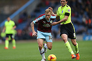 Burnley midfielder Scott Arfield (37), Brighton central midfielder, Dale Stephens (6) during the Sky Bet Championship match between Burnley and Brighton and Hove Albion at Turf Moor, Burnley, England on 22 November 2015.