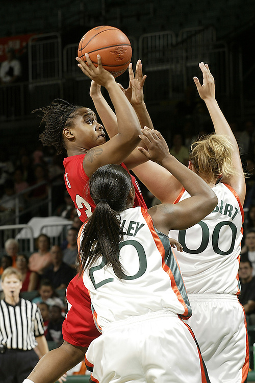 North Carolina State guard Shayla Fields shoots over University of Miami forwards Amy Audibert (00) and Albrey Grimsley (20) during the Wolfpack's 77-53 victory over the Miami Hurricanes on February 24, 2007 at the BankUnited Center in Coral Gables, Florida.