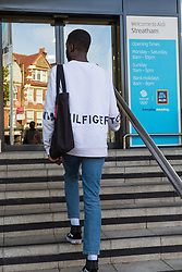 Lance enters Aldi where he was unable to obtain a knife in an exercise where a 17-year-old visited numerous big brand shops on Streatham High Road in an attempt to purchase a knife to illustrate the extent of knife control and age checking in London stores. Streatham, London, August 30 2019.