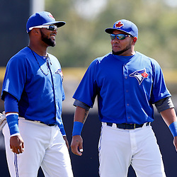 Mar 5, 2013; Dunedin, FL, USA; Toronto Blue Jays left fielder Melky Cabrera (right) and second baseman Emilio Bonifacio (left) talk before a spring training game against the Baltimore Orioles at Florida Auto Exchange Park. Mandatory Credit: Derick E. Hingle-USA TODAY Sports