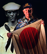 Art Williams holds a flag recovered from a dead pilot in a downed Japanese bomber after the attack on Pearl Harbor. Williams was a machinist mate 1st class on the USS Vestal. The repair ship was docked on the outboard side of the USS Arizona which was ripped by a hugh explosion during the attack on December 7, 1941.