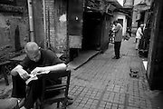 Chongqing's old town is scheduled for destruction. Nestled in the heart of the city and riddled with small alley ways and a wonderfully communal sense of life people spend their days outside playing badminton in the street chatting with neighbors and playing ma jiang away from the modernization taking place just beyond the walls.