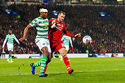 Dedryck Boyata (#20) of Celtic battles for the ball with Niall McGinn (#10) of Aberdeen during the Betfred Cup Final between Celtic and Aberdeen at Celtic Park, Glasgow, Scotland on 2 December 2018.