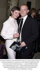 Actress CAMILLA RUTHERFORD and her close friend RUFUS, at an exhibition in London on 19th March 2002.OYK 82