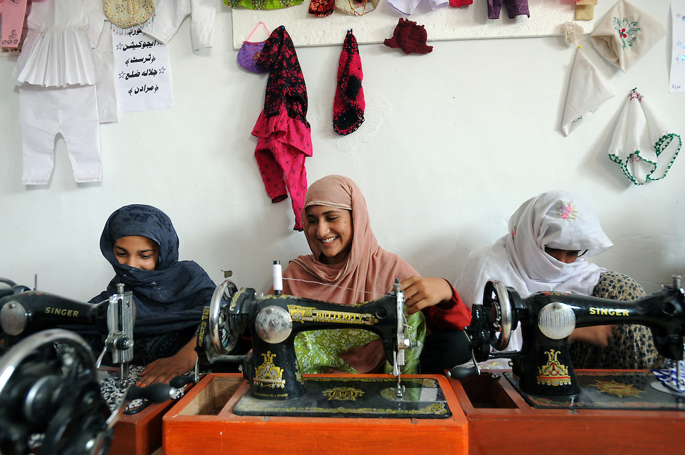 Women, forced to flee their homes learn how to sew in a refuge in Jalala, Pakistan