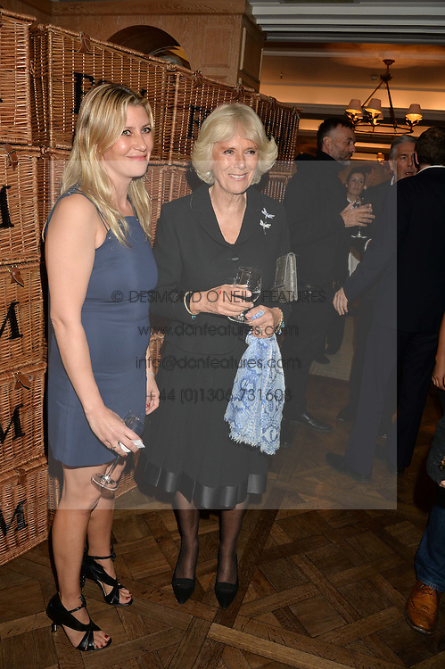 Left to right, SARA PARKER BOWLES and her mother in law HRH The DUCHESS OF CORNWALL  at a party to celebrate the publication of 'Let's Eat meat' by Tom Parker Bowles held at Fortnum & Mason, Piccadilly, London on 21st October 2014.