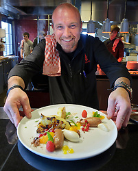 MALDEGEM, BELGIUM - JUNE-18-2011 - Peter De Clercq presents his version of grilled pineapple, with white and milk chocolate mouse and seasonal fruits, in his kitchen at Elckerlijc. (Photo © Jock Fistick)