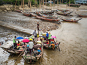 30 OCTOBER 2015 - YANGON, MYANMAR:  Small boats that run from Dala to Yangon load up near the Dala ferry. The ferry to Dala runs continuously through the day between Yangon and Dala. Yangon, Myanmar (Rangoon, Burma). Yangon, with a population of over five million, continues to be the country's largest city and the most important commercial center.          PHOTO BY JACK KURTZ