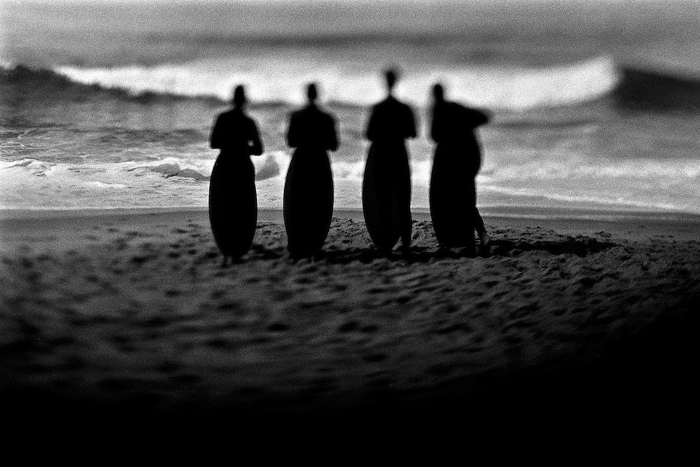 Artistic black and white image of body boarders in California.