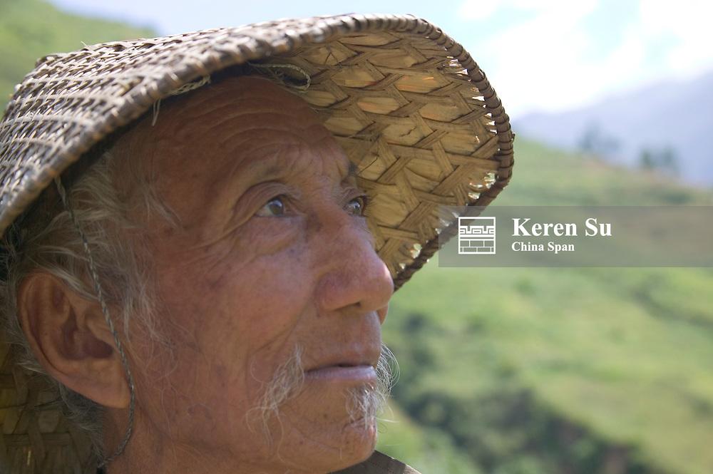 Portrait of an old farmer wearing bamboo hat, Trashing Yangtse Valley, east Bhutan, MR