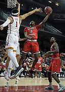 Western Kentucky Hilltoppers guard Josh Anderson (4) is defended by Southern California Trojans guard Jordan Usher (1) in the first half during an NCAA college basketball game in the second round of the NIT tournament in Los Angeles, Monday, Mar 19, 2018. WKU defeated USC 79-75.